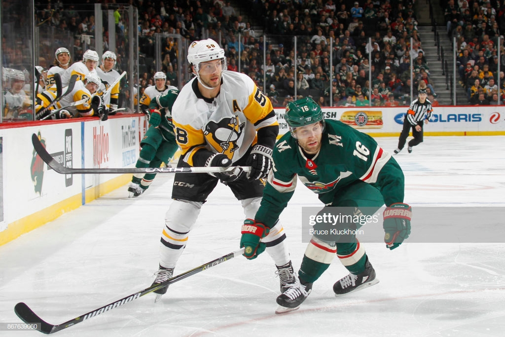 A hockey game in the snow  Description automatically generated